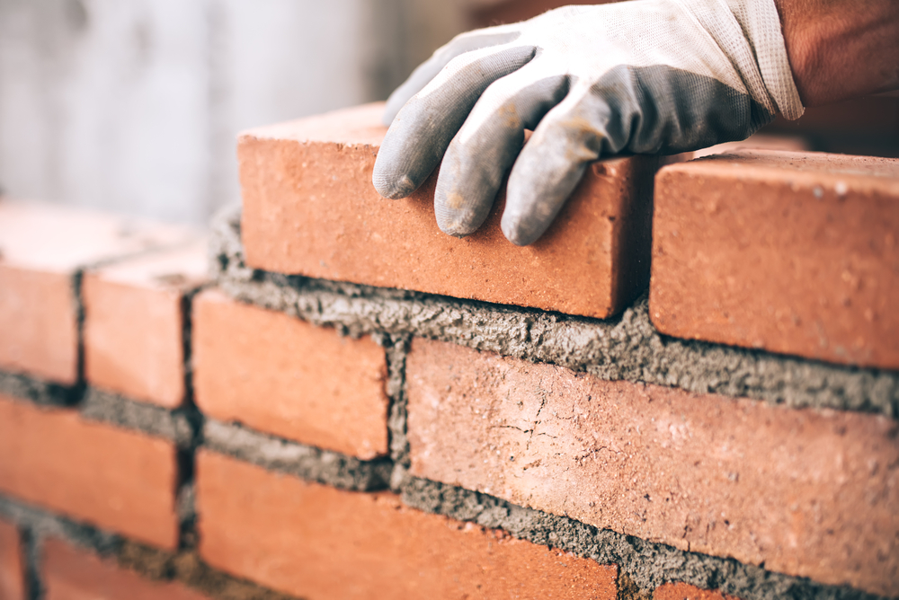 Cement brick and mason to make a wall